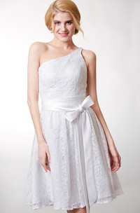 Beautiful Knee Length Lace Dress One Shoulder Neckline and Fitted Cut Flattering