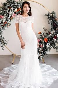 Elegant Lace Bateau Sheath Short Sleeve Wedding Dress with Appliques and Keyhole Back
